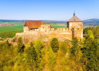 Aerial view of Tocnik Castle. A royal chateau of Wenceslas IV from the 14th century, adjusted in the Renaissance and the Baroque styles. Famous Czech monument from above.