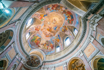 """The painted vault with the """"Apotheosis of Saint James"""" by Silverio Capparoni, in the Church of San Giacomo in Augusta, in Rome, Italy."""