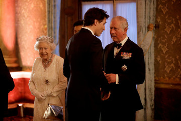Britain's Prince Charles greets Canadian Prime Minister Justin Trudeau beside Britain's Queen Elizabeth in a receiving line for the Queen's Dinner for the Commonwealth Heads of Government Meeting at Buckingham Palace in London