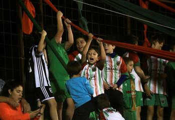 Children cheer for Agropecuario soccer team during their Argentine Second Division match against Almagro in Carlos Casares