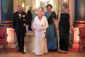 Britain's Queen Elizabeth, Prince Charles, Commonwealth Secretary-General Patricia Scotland and Prime Minister Theresa May pose in the Blue Drawing Room at Buckingham Palace in London