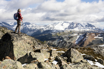 Female hiker looking at view of Garibaldi Provincial Park, Canada