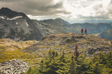 Father and son hiking on rocky ridge, Merritt, British Columbia, Canada