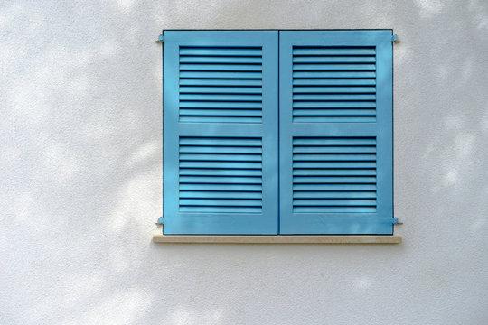 white wall with blue window stutter