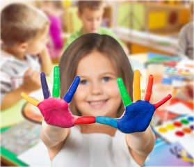 Cute little girl with colorful hands