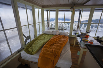 Sleeping bags on bed inside Pickett Butte Fire Lookout near Tiller, Oregon, USA