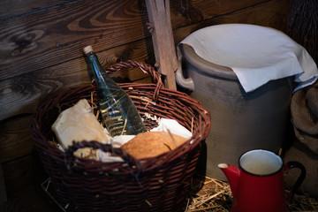 A bottle of vodka in a wicker basket. Drinks in a glass bottle in a wicker basket.