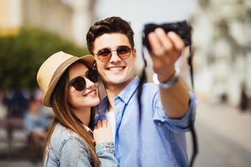 Tourist couple taking selfies during traveling in new city. Travel