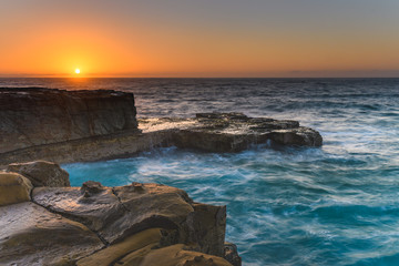 Sun rising over the Headland - Seascape