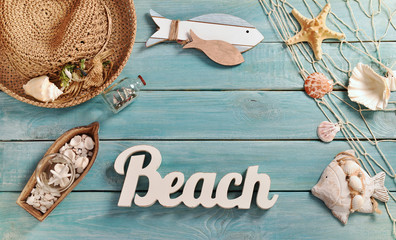 summer bacground with beach accessories on blue wooden board