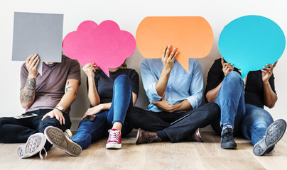 Group of diverse people with speech bubbles icons Wall mural