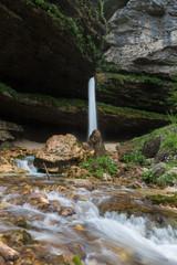 Upper Pericnik waterfall in Slovenian Alps in autumn, Triglav National Park.