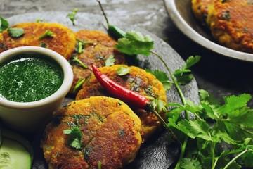 Alu Ki Tikki /  Potato (Aloo) Patties served with cilantro chutney