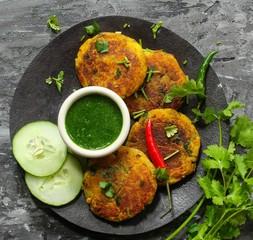 Aloo Tikki /Potato Patties served with cilantro chutney