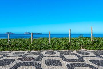 Fotomurales - Famous Ipanema Sidewalk Mosaic and Ocean in the Horizon, Rio de Janeiro, Brazil