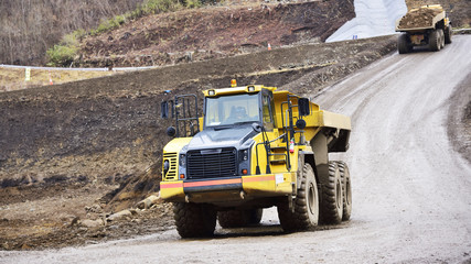 Heavy articulated dump truck work at a huge site