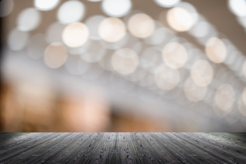 Top wood table over abstract light bokeh background. for product display montage.