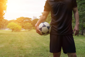 Man playing soccer football for exercise at public garden - World cups concpet.