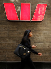 A woman walks past a Westpac bank branch in Sydney