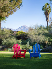 Red and Blue Adirondack Chairs at Morning