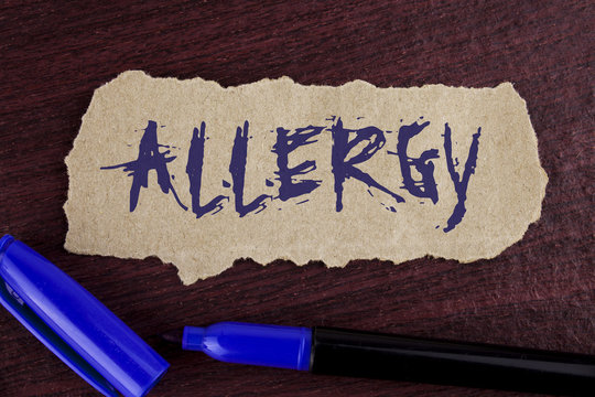 Handwriting text writing Allergy. Concept meaning damages in immunity due to hypersensitivity get it diagnised written on Tear Cardboard paper piece on wooden background Marker next to it.