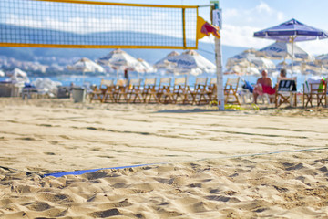 Beach volleyball court in hot summer day ready for game. Selective focus.