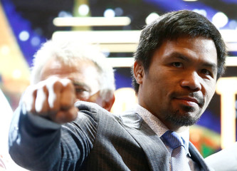 """Philippine boxing icon Manny """"Pacman"""" Pacquiao poses for photographers during a news conference in Kuala Lumpur"""