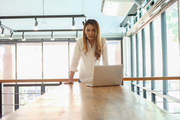Portrait of millennial hispanic businesswoman in boardroom