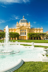 Art pavilion and fountain in Zagreb capital of Croatia, beautiful spring day, colorful architecture, outdoor