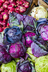 heap of violet purple cabbage in retail vegetable super market for sale
