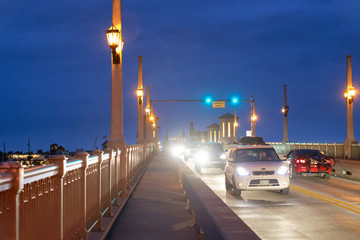 ST AUGUSTINE, APRIL 8, 2018: City night traffic along Bridge of Lions. St Augustine is a famous attraction in Florida