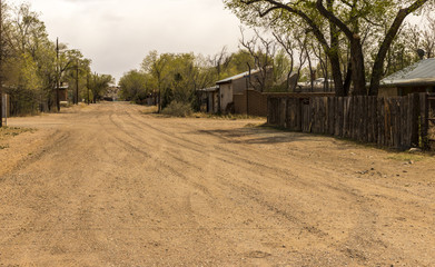 Unpaved streets in the historical mining town of Cerrillos, New Mexico. Located along the historic Turquoise Trail and Route 66, scenic byway between Santa Fe and Albuquerque, NM.
