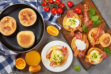 Eggs Benedict on plate and on board