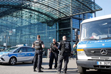 Police officers stand in front of the central train station while a World War Two bomb is defused in Berlin