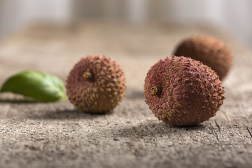 ychees fruit on old wooden background