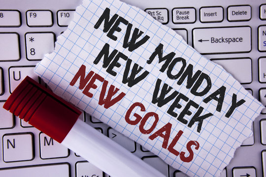 Conceptual hand writing showing New Monday New Week New Goals. Business photo text next week resolutions To do list Goals Targets written on Tear Notebook paper placed on the Laptop Marker next to it.