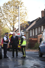 Local MP Iain Duncan Smith talks to firefighters at the scene of a large fire in a residential care home  in Connington Crescent, Chingford, north-east London