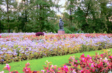 View of a large flower bed and sculpture of Venus with Cupid Kapuansky in Catherine Park of Tsarskoe Selo