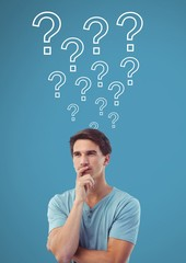 Man thinking with question marks