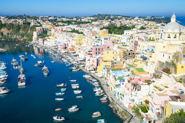 Beautiful view of traditional fishing boats moored in Corricella harbour on the island of Procida, Italy.