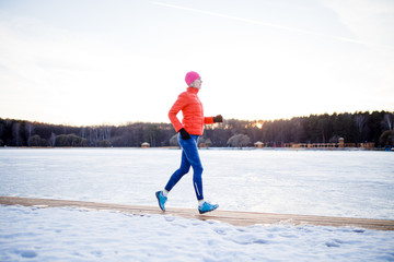 Image of sports girl on morning exercise in winter