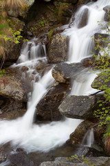 Small waterfall of a creek downhill to the Gran Paradiso National Park