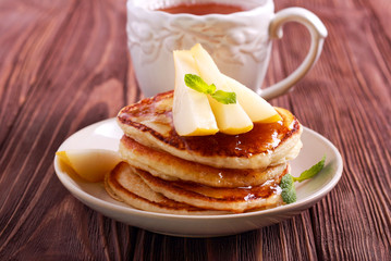 Pear and honey pancakes on plate