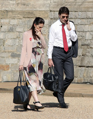 New Zealand's Prime Minister Jacinda Ardern and Canada's Prime Minister Justin Trudeau walk through the grounds of Windsor Castle in Windsor