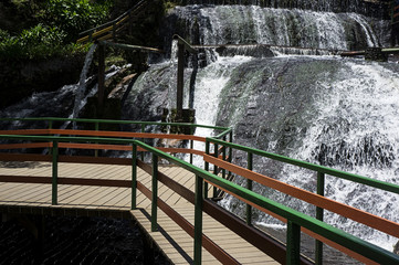 tourism destination Campos do Jordao Brasil water pipe wooden bridge
