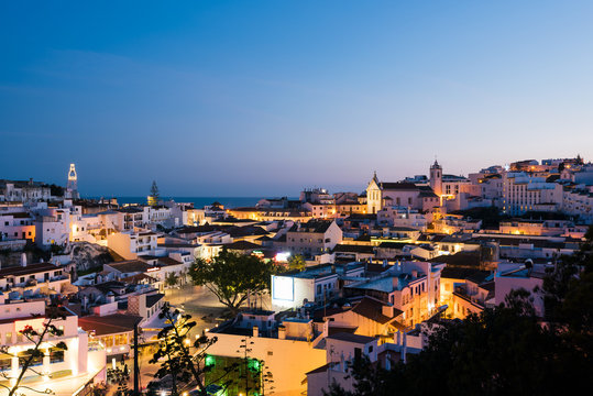 Panoramic, night view of the Old Town of Albufeira City in Algarve, Portugal. Albufeira is a coastal city in the southern Algarve region of Portugal.
