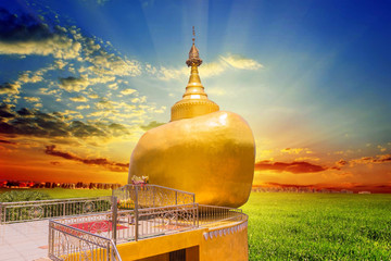 The replica of Phra That In-Kwaen (Hanging Golden Rock) with Sunset background, Sirey temple, Phuket, Thailand.