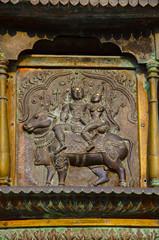 Carved idol on the inner wall of the Brihadishvara Temple, Thanjavur, Tamil Nadu, India.