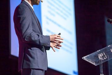Speaker at business presentation or conference