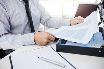 Insurance concept, businessman signing a car insurance policy